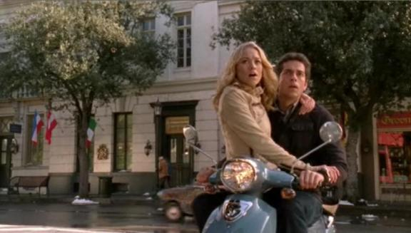 Chuck versus Honeymooners -Sarah and Chuck handcuffed on scooter